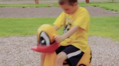 Boy playing at the playground — Stock Video