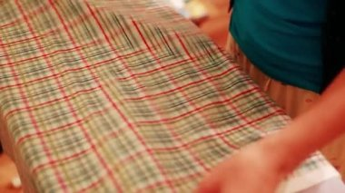 A woman irons cotton fabric — Stock Video