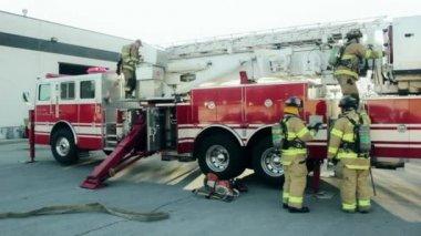 Firefighter at firetruck outdoors — Stock Video