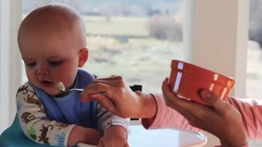 Boy being fed by his mother — Stock Video