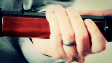Gunman holding rifle — Stock Video