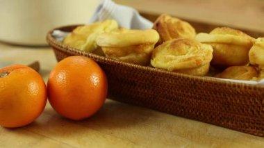 Freshly baked orange rolls — Stock Video