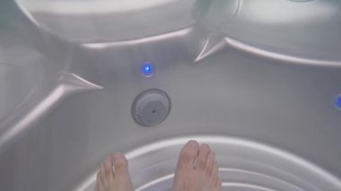 Feet in the hot tub — Stock Video