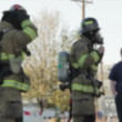Firefighters putting out a fire — Stock Video #70430291