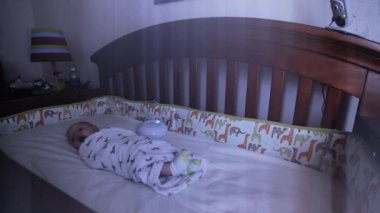 Newborn baby in crib — Stock Video