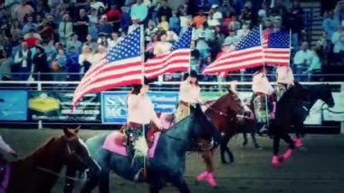 Women with flags riding horses — Stock Video