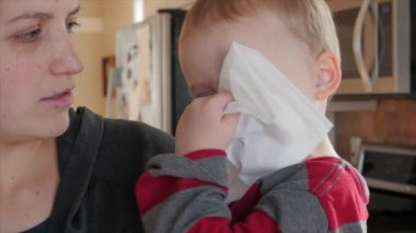 Boy blows nose into kleenex — Stock Video