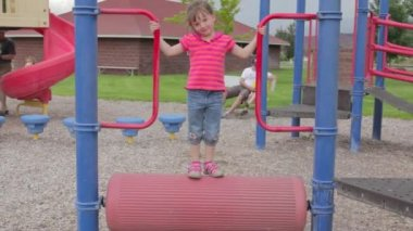 Girl playing on playset — Stock Video