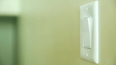 Hand turns on light switch — Vídeo de stock