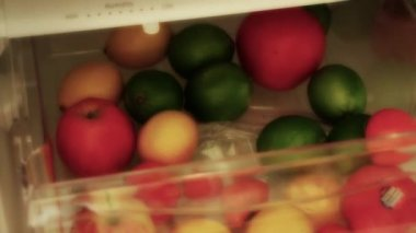 Man puts fruit into drawer — Stock Video