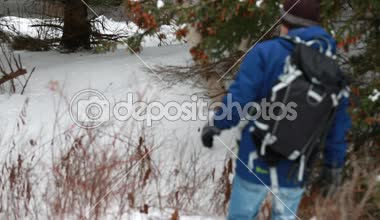 A man hiking in snowshoes — Stock Video