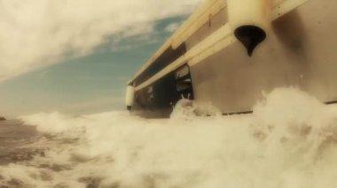 Fishing boat cruising through the ocean — Stock Video