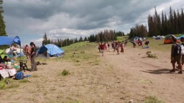 People at the annual rainbow gathering — Stock Video