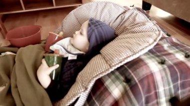 Sick boy lying on floor — Stock Video