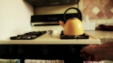Tea kettle heating on the stove — Stock Video