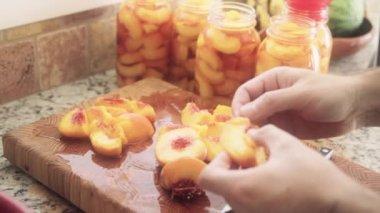 Woman skinning peaches — Wideo stockowe