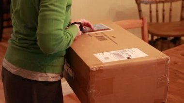 Woman opening package in home — Stock Video