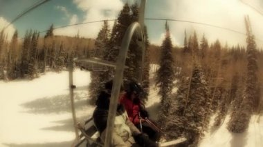 Pair on the ski chair lift — Stock Video