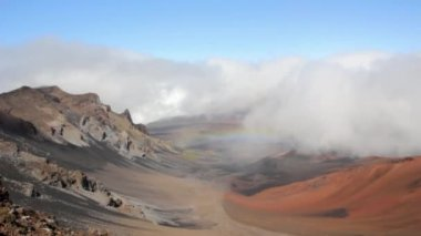 Rainbow hovers over crater — Stock Video