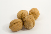 Four Walnuts on a White background - unopened — Stock Photo