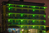 Green Night Time Building — Stock Photo