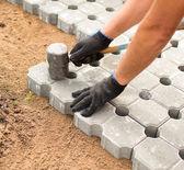 Worker Building Concrete Bricked Floor — Stock Photo