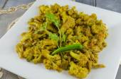 Cauliflower florets cooked with green peas and spices — Stock Photo