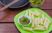Ready to cook pasta with pesto sauce — Stock Photo