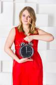 The girl with a clock — Stock Photo