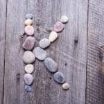 Stone alphabet - K — Stock Photo #67366319