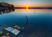 Lake at sunset. Boats mooring place. — Stock Photo