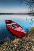Lake landscape with boat — Stock Photo