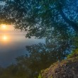 Beautiful sunrise over misty lake. — Stock Photo #71217305