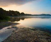 Beautiful sunrise over misty lake. — Stock Photo