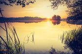 Sunset over calm lake — Stock Photo