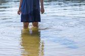 Girl standing in lake water — Stock Photo