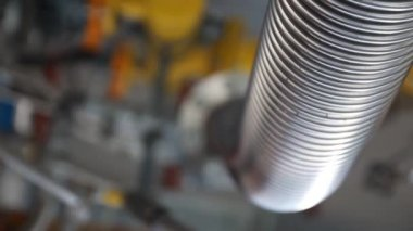 Trembling corrugated pipe on the equipment — Stock Video