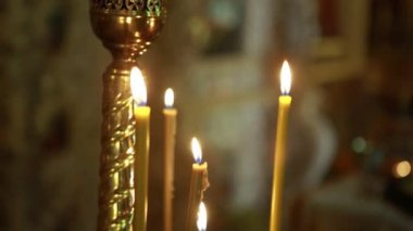 Many candles burning in church — Stock Video