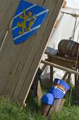 Medieval shield and helmet near with knights camp — Stock Photo