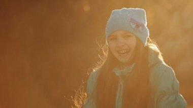 Child laughing in sunset ligh CU — Stock Video