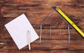 Shape of a home building and paper - Stock Image — Stock Photo
