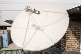 Satellite dish on the roof, white — Stock Photo