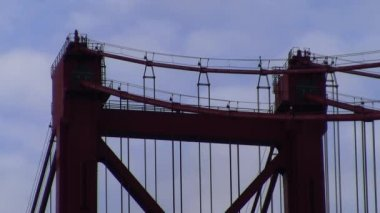 Red bridge tower top and suspender cable closeup — Stock Video
