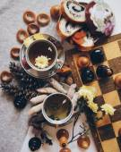 Tea, bagels, baking and chessboard — Stock Photo