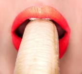 Sexy woman eating banana — Stock Photo