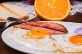 Fried egg and bacon for breakfast for a loved one — Stock Photo