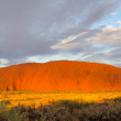 Sunset at Uluru Ayers Rock with red color and clouds — Stock Photo #67442757