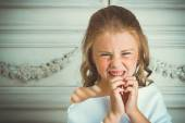 Evil emotion and smile, little beautiful angel in white robe — Stock Photo