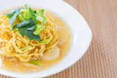 Pan fried noodles with pork. — Stock Photo
