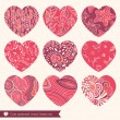 A vector illustration of nine various lace fretwork hearts set — Stock Vector #72336709